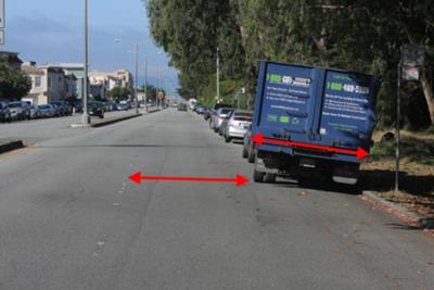 Red arrows show width of truck and remaining width in lane, both about 8 feet across