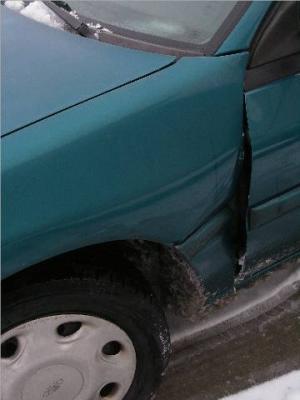 Escort - damaged driver's side front fender and door